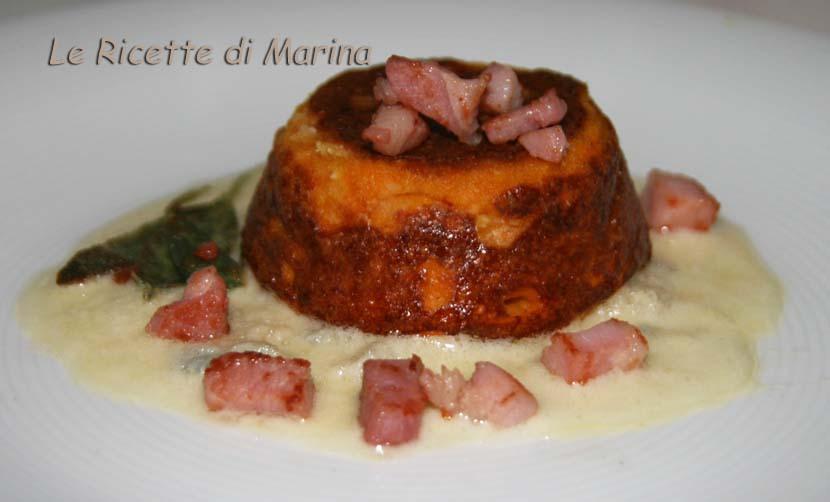 Sformatini di zucca su fonduta di formaggio con pancetta croccante