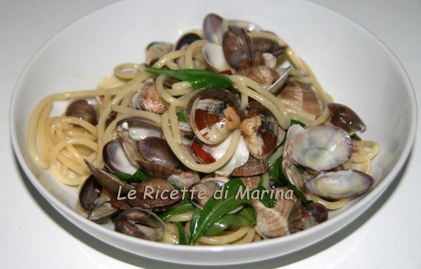 Spaghetti frutti di mare e rucola