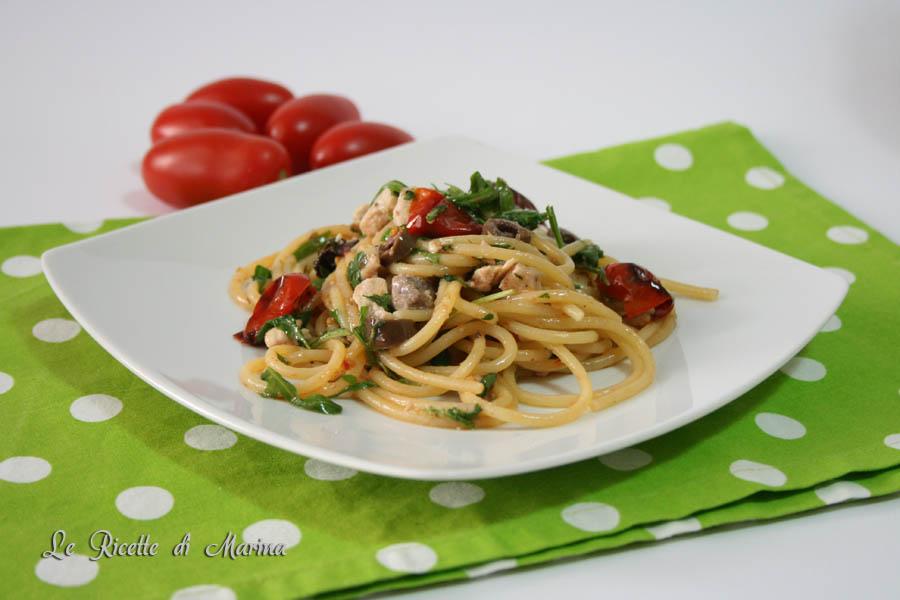 Spaghetti con ricciola rucola e pomodorini