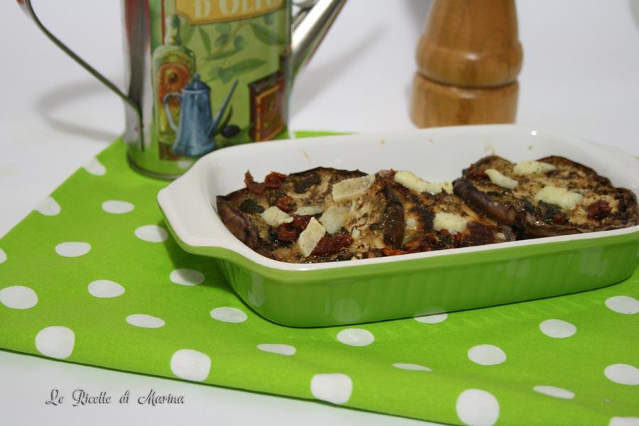 Melanzane con pecorino e pomodori secchi