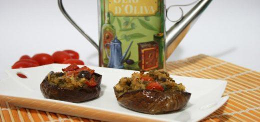 Melanzane ripiene di pane pomodori e olive