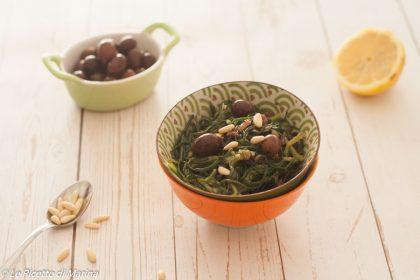 Insalata di agretti con olive e pinoli